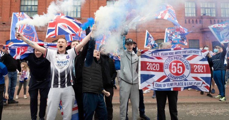 Hundreds of Rangers fans celebrate at Ibrox with huge crowds and smoke bombs
