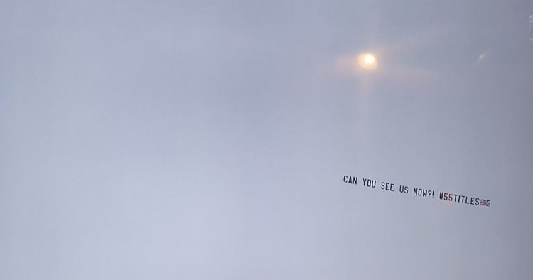 Rangers fans troll Celtic with 'can you see us now' banner flying over Tannadice